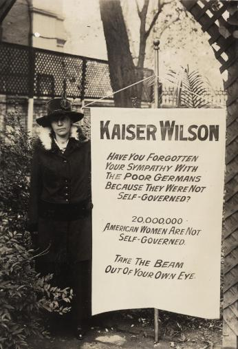 Virginia Arnold holding Kaiser Wilson banner, 1917. (Source: Library of Congress)