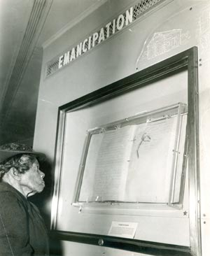 Sally Fickland, the oldest living former slave, views the Emancipation Proclamation in 1947. (Source: National Archives)