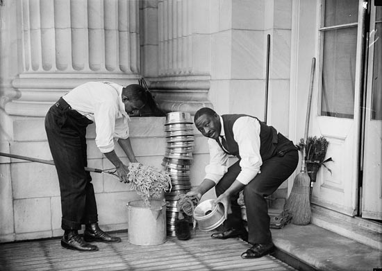 U.S. Capitol custodians cleaning spittoons in 1914. (Source: Harris & Ewing Collection at the Library of Congress)
