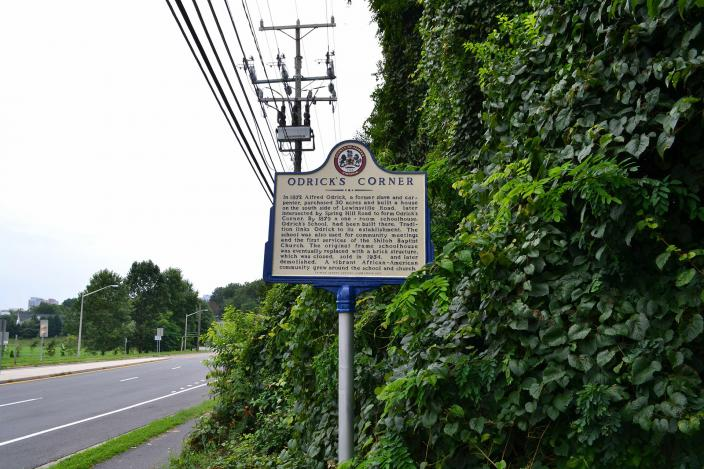 Roadside historical marker detailing the history of Odrick's Corner in Fairfax County. (Credit: Jacob Kaplan)