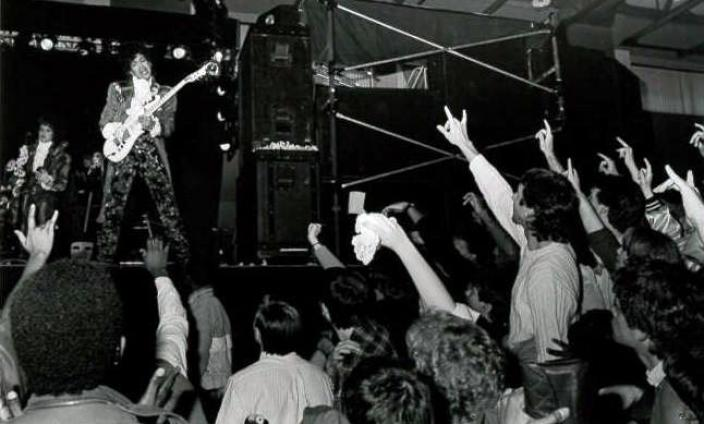 "Prince on stage mid-performance, with the crowd throwing up ""I Love You"" signs. (Photo: Courtesy of the Gallaudet University Archives)"