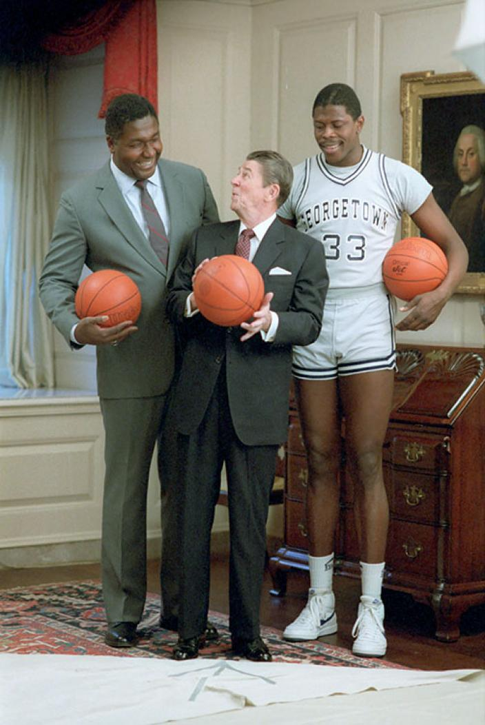 Georgetown University basketball coach John Thompson, Jr., shown here with President Reagan and Patrick Ewing, requested a meeting with Edmond after learning that he had befriended some Georgetown players.