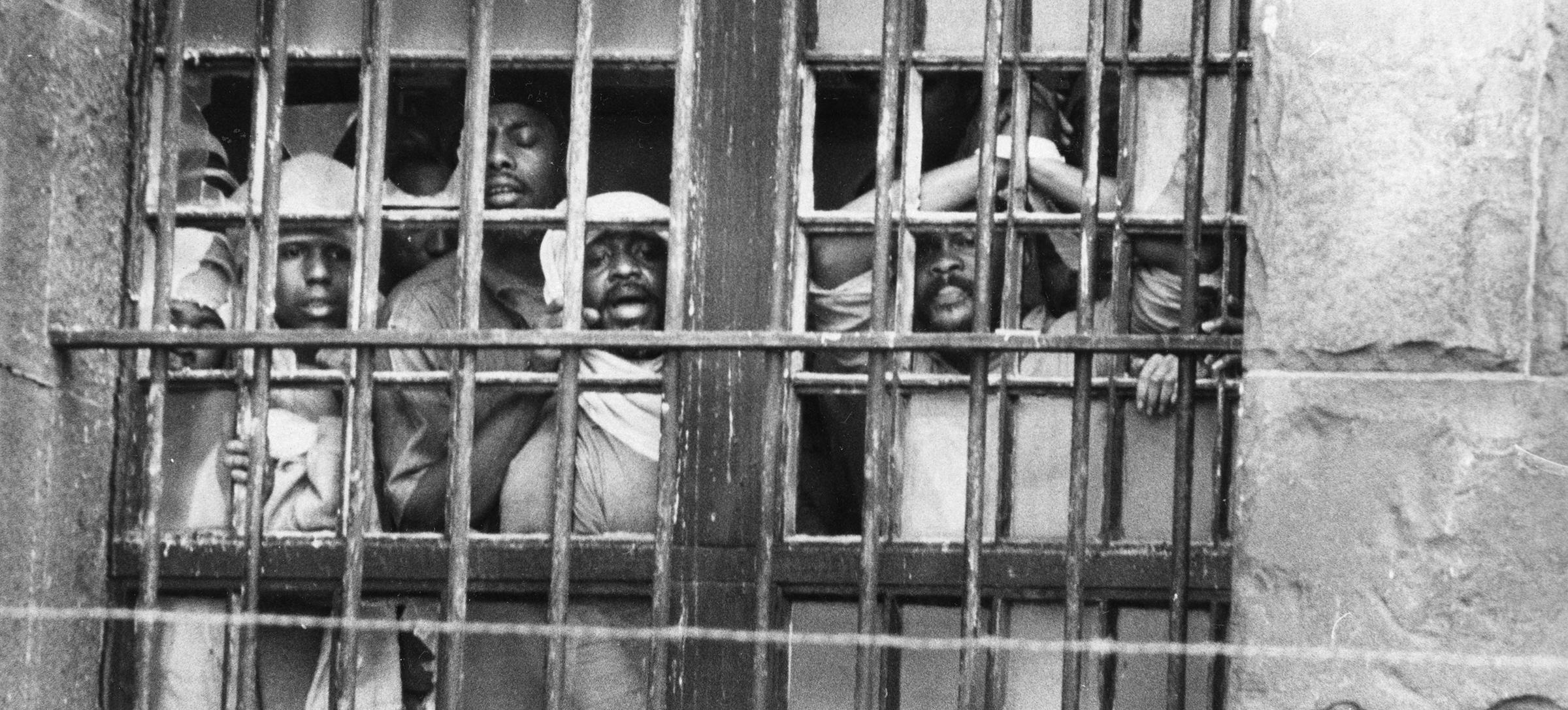 Inmates shouting through D.C. Jail window during the hostage standoff on October 11, 1972. (Photo Credit: Unknown, Courtesy DC Public Library, Star Collection, © Washington Post, All Rights Reserved.)