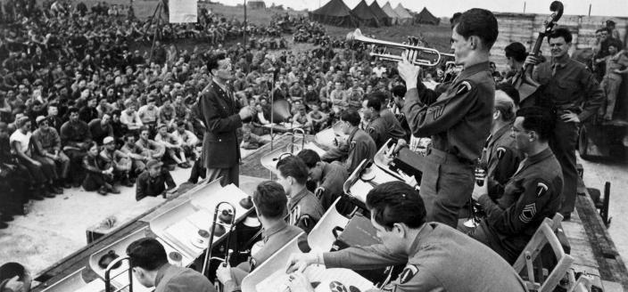 Glenn Miller's band plays for US and Allied troops in England, Jun-Dec 1944. (Photo Source: U.S. Air Force, Public Domain) http://www.nationalmuseum.af.mil/Visit/Museum-Exhibits/Fact-Sheets/Display/Article/196150/maj-glenn-miller-army-air-force-band/