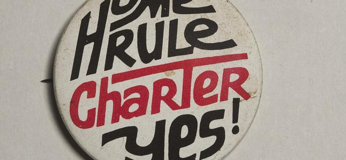 """Button that reads """"Home Rule Charter, YES,"""" urging District residents to adopt the Home Rule charter in 1974"""