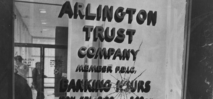 Bullet hole in the door of Arlington Trust Company bank in Crystal City, where the Tuller's crime spree began in 1972. (Reprinted with permission of DC Public Library, Star Collection © Washington Post)