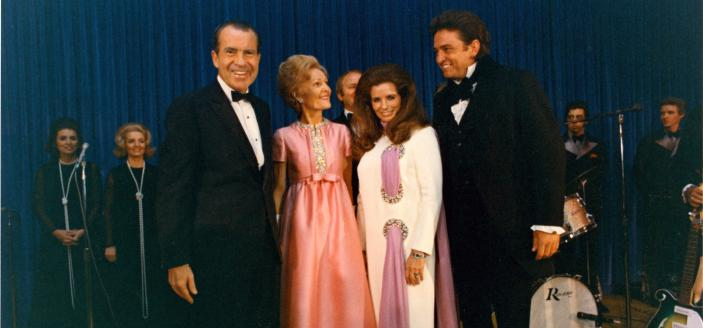 The Nixons and the Cashes pose for a photo on the evening that Cash performed at the White House. Image Source: National Archives.