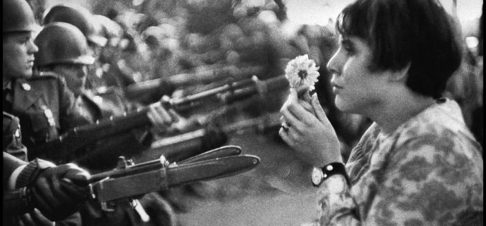 Jan Rose Kasmire, confronts National Guard troops during Vietnam War protest outside Pentagon on October 21, 1967 (Photo by Marc Riboud, licensed from Magnum Photos)