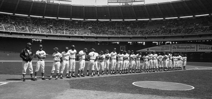 Washington Senators team stands on first baseline at RFK Stadium, April 5, 1971. (Photo by Marion S. Trikosko, U.S. News & World Report Magazine Photograph Collection at the Library of Congress)