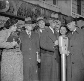 Commissioner Melvin Hazen and William Van Duzer, putting the first nickel in the parking meters ordered by Congress for a test in Washington in November 1938. (Source: Library of Congress)
