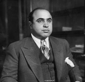 Al Capone in 1930 as photographed by the FBI's Chicago Bureau (Source: Wikipedia)
