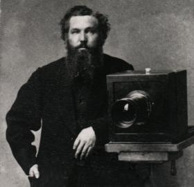 Portrait of Alexander Gardner with a camera, taken around 1860