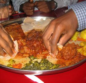 Traditional Ethiopian injera dish (Source: Wikipedia. Photo by Richard from kansas city, united states - grab it and then eat it, CC BY 2.0, https://commons.wikimedia.org/w/index.php?curid=2336325)