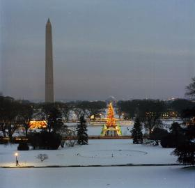 View of the Washington Monument and Jefferson Memorial from the White House, covered in snow