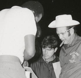 "Coach ""Lefty"" Driesell puffed on a cigar while his players huffed and puffed around the track at midnight on October 15, 1971. (Photo source: NCAA.com)"