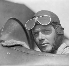Charles Lindbergh, wearing helmet with goggles up, in open cockpit of airplane at Lambert Field, St. Louis, Missouri, 1923. (Source: Library of Congress)