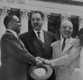 George E.C. Hayes, Thurgood Marshall, and James Nabrit Jr congratulate each other outside of the Supreme Court on the day of the decision