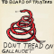 """A white rectangular poster depicts a message handwritten by a Gallaudet student during the """"Deaf President Now"""" protests. """"To Board of Trustees"""" is written at the top of the poster followed by an image of a coiled red snake. Below the snake is a statement in capital letters that reads """"Don't tread on Gallaudet we want a deaf presidents now and demand four things. Deaf never give up."""""""